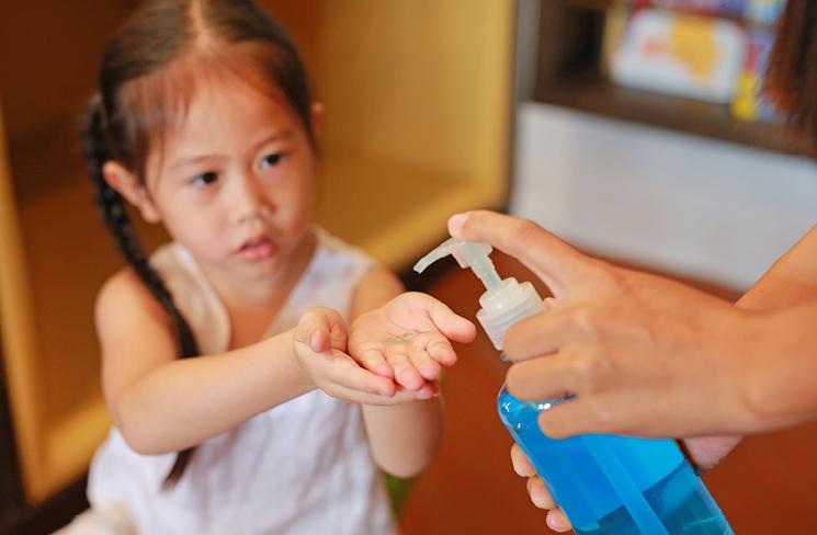 Child receiving hand sanitizer